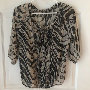Shear animal print express blouse